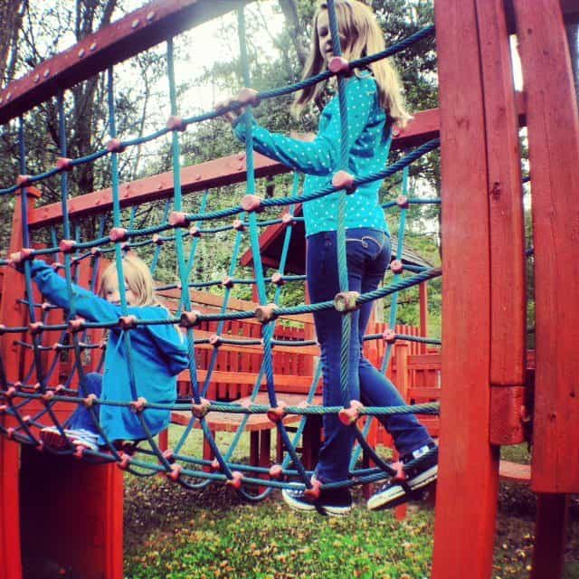 The girls enjoyed the outdoor play area in the extensive woodland grounds.