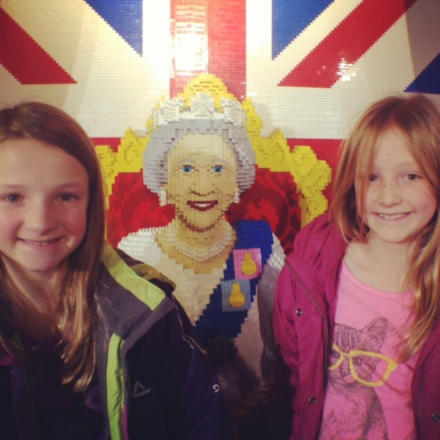 The girls on the top floor at Hamleys with a life sized lego queen!
