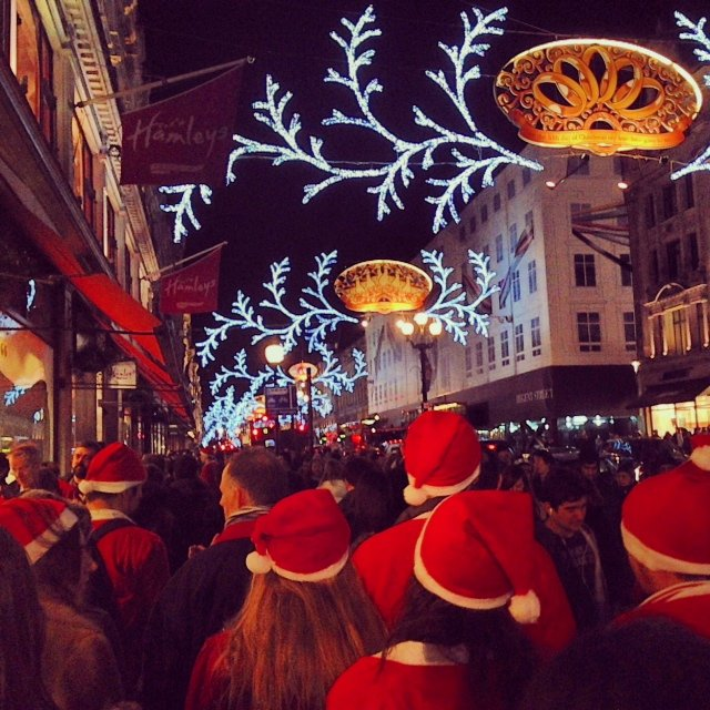 Checking out all the Christmas lights on Regent Street. We later found out that all the Santas were part of Santacon.