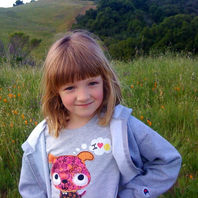 Here's my middle child on a hike in Rancho San Antonio, near San Francisco, learning about wildflowers. Those are California poppies behind here, they are the state flower.