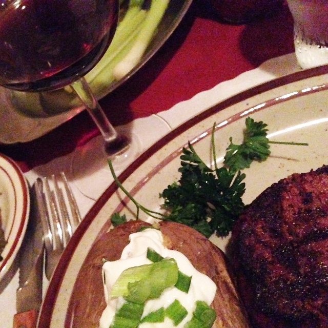 Baked potato with sour cream and chives, 5 oz filet mignon and a glass of Halter Ranch Cabernet at The Hitching Post I in Casmailia, California #travel #foodie #wine