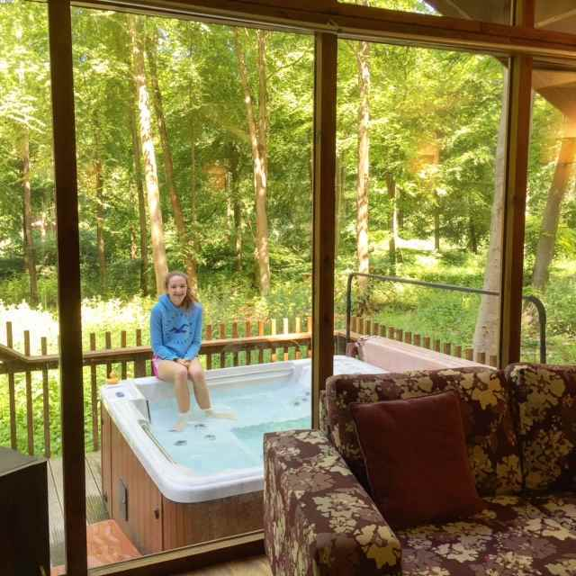 Many of the Forest Holidays cabins come with a hot tub in the outdoor patio.
