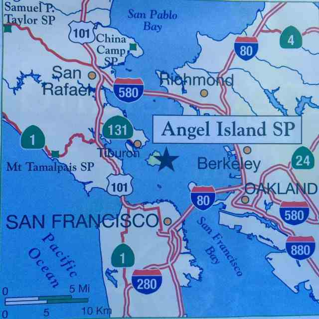 This map gives you an idea of where Angel Island is in San Francisco Bay (it's the big star). The little dot below it is Alcatraz.