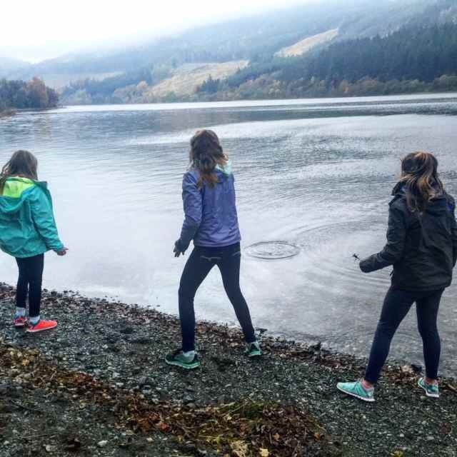 Skimming stones on Loch Lubnaig at Forest Holidays, Strathyre