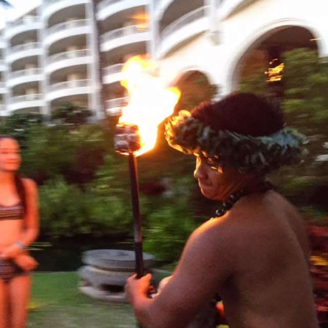 Ever wonder how all the tiki torches are lit each evening at the Fairmont Kea Lani? It's the torch lighting ceremony, every night at sunset in the summer. Just look for all the kids following him around!