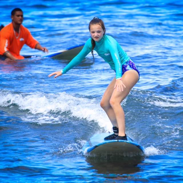 Under the watchful eye of her Ka'anapali Surf Club instructor, Anoai, middle daughter catches her first wave of the day! Thanks to @farmingsurfer for taking this awesome pic