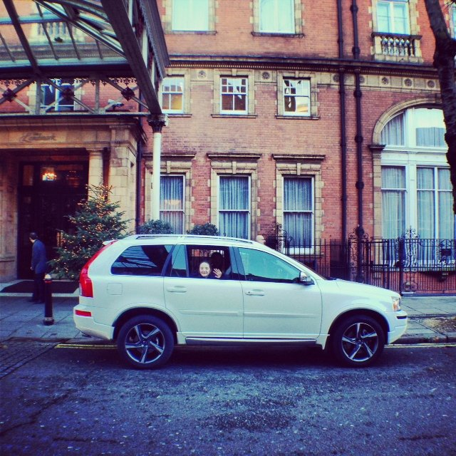 Our #volovconcierge day has started! We were picked up in a shiny white XC90. That's my smiley 11-year-old waving.