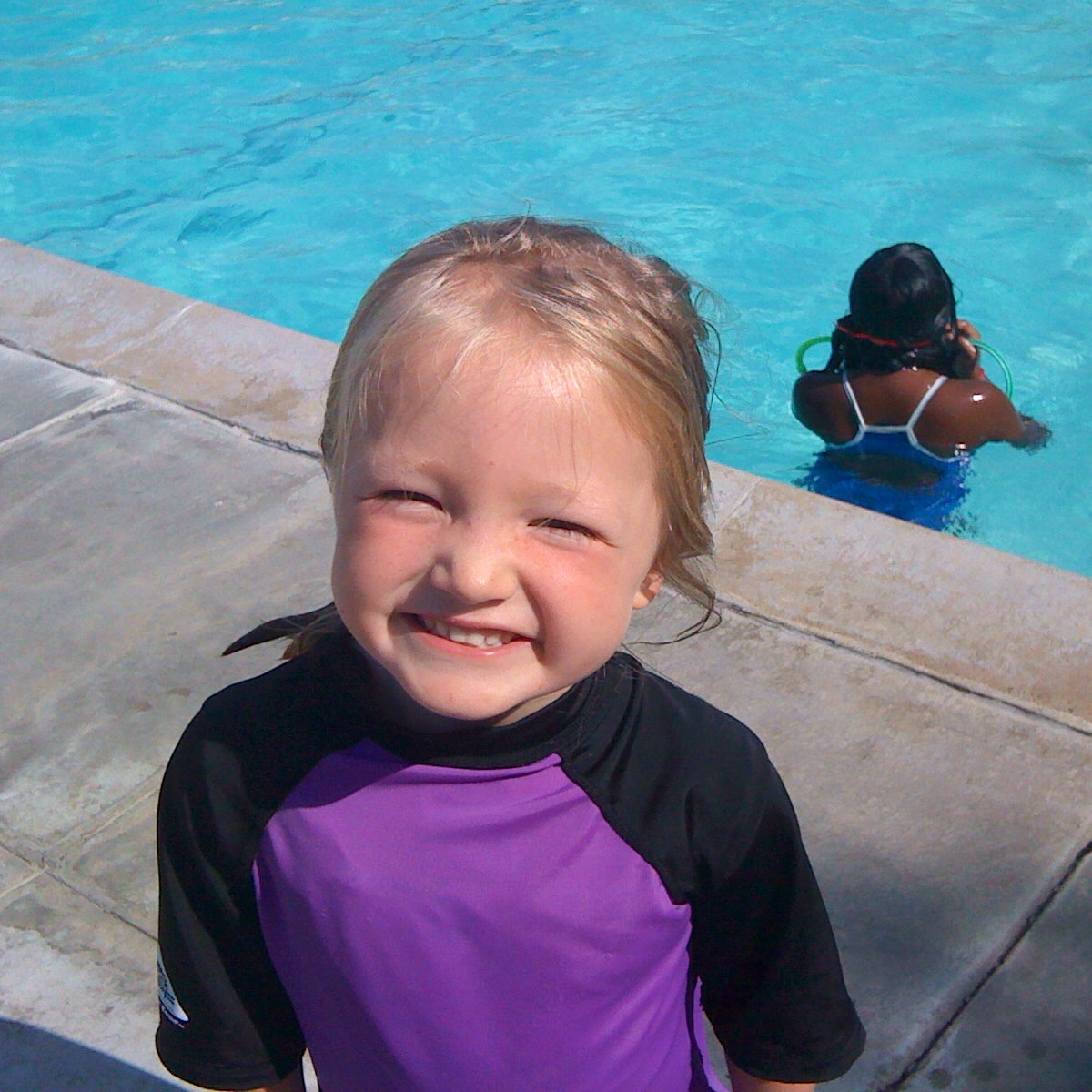 Here's my youngest, aged 4, learning to swim in San Jose, California. She had been to several swim lessons that year, but it finally clicked for her on this trip.