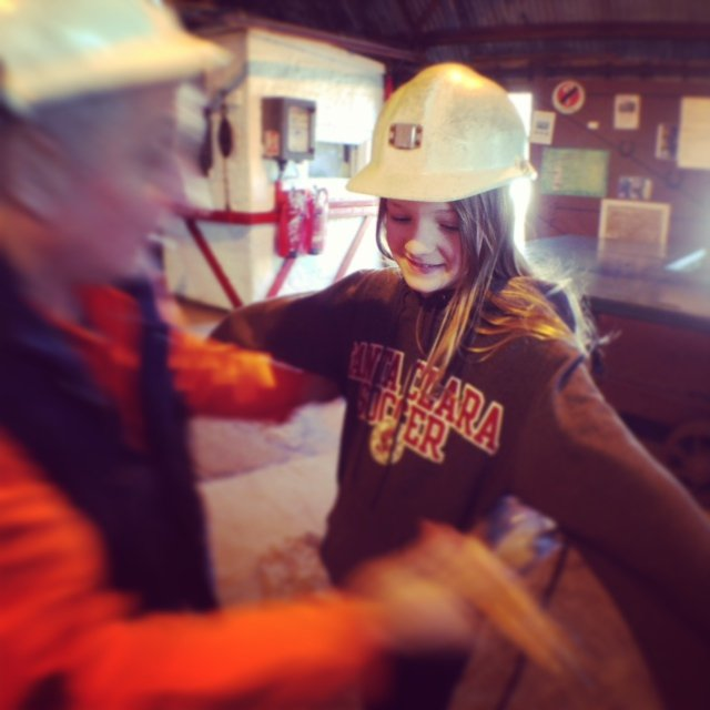 Getting kitted out in miner's gear and ready to descend 300 feet into the heart of the Big Pit coal mine.
