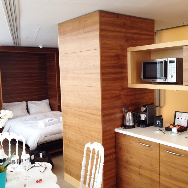 Here's the other half of our Penthouse suite. It had a double pull down bed and kitchenette area with Nespresso machine.