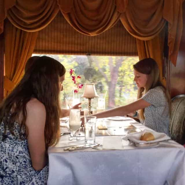 Who doesn't love dinner on a train?!! We're on the table directly opposite enjoying a Jamieson Ranch cab while the girls keep busy with the view and a game of Clue. #perfecteveing