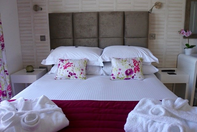 The bedroom at The Residence Gwel an Mor are bright and cheery and come with lots of luxurious extras, like tktkkt