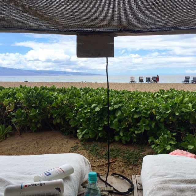 The view from our cabana on Ka'anapali Beach looks on to the smaller island of Lanai. It's 88F and there's a bit of a breeze which goes well with my iced water