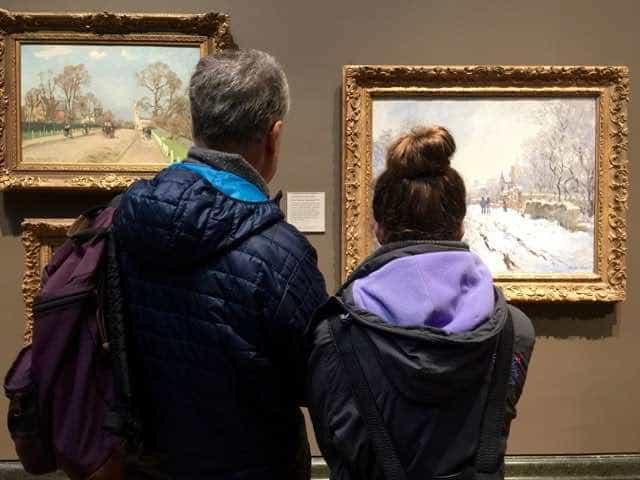 Examining paintings at the National Gallery.